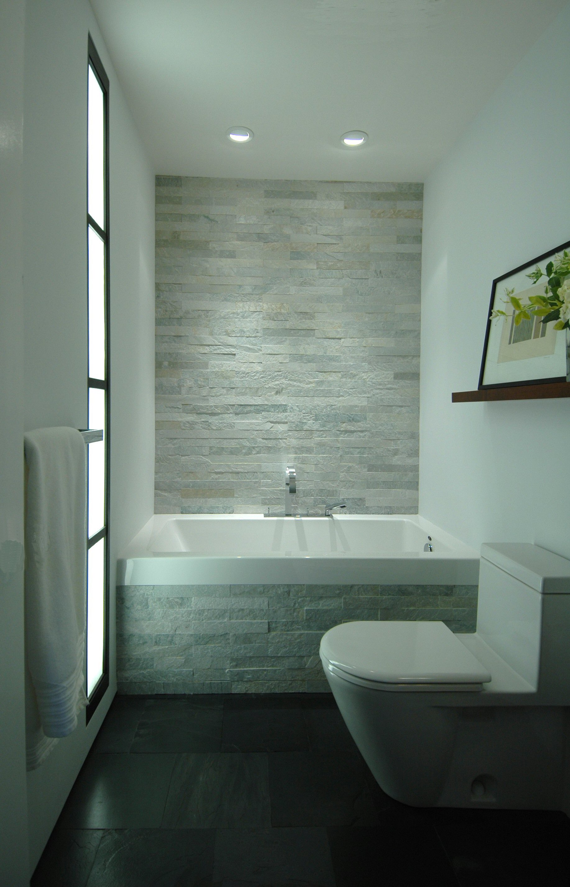 Modern spa-like bathrooms created from ordinary, windowless bathrooms.